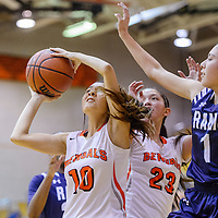Gallup Bengal Paige Juan (10) attempts to shoot past a block from Rio Rancho Ram Laura Gutierrez (1) Saturday at Gallup High School.