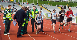 As Paramedics move into help exhausted runner they are told by Race officials not to touch Deborah Richards of Sheffield Running Club as she struggles to finish the Sheffield Half Marathon. Deborah collapsed after staggering in to Don Valley Stadium before beginning to crawl for the finish line <br />
