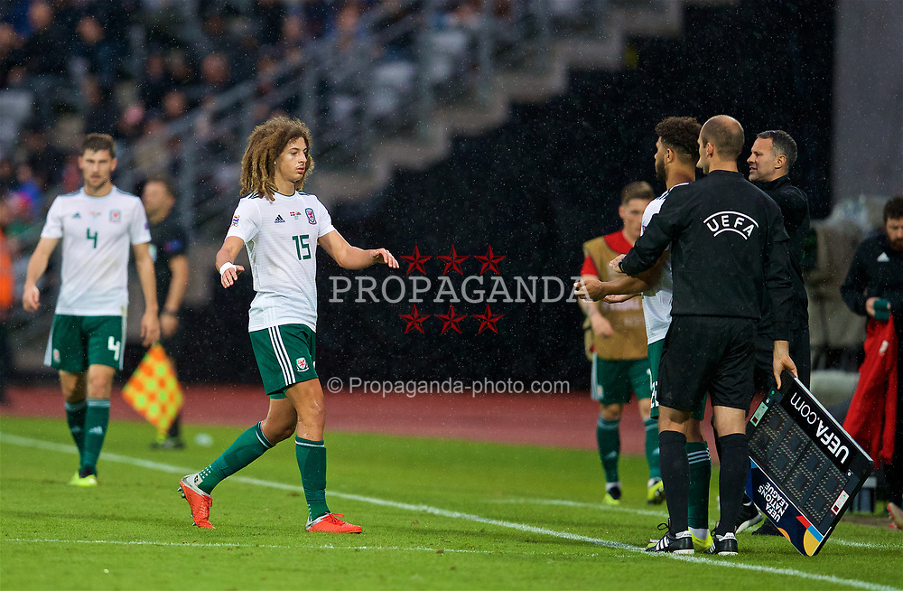 AARHUS, DENMARK - Sunday, September 9, 2018: Wales' Ethan Ampadu is replaced by substitute Tyler Roberts during the UEFA Nations League Group Stage League B Group 4 match between Denmark and Wales at the Aarhus Stadion. (Pic by David Rawcliffe/Propaganda)