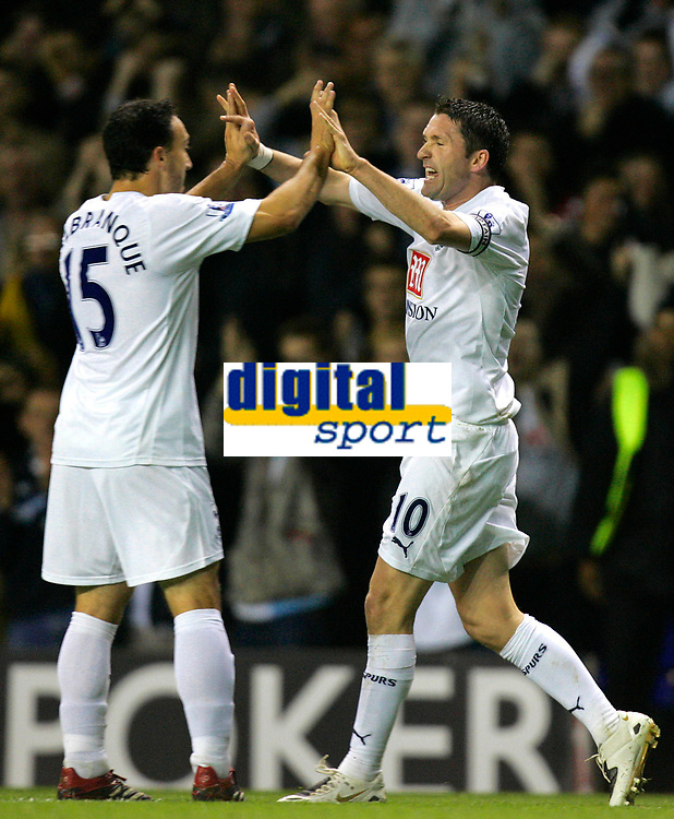 Photo: Tom Dulat.<br /> <br /> Tottenham Hotspur v Blackpool. Carling Cup. 31/10/2007.<br /> <br /> Robbie Keane(R) celebrates his opener for Tottenham Hotspur, Tottenham leads 1-0, in the picture with Steed Malbranque