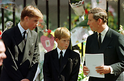 The Prince of Wales, Prince William and Prince Harry wait outside Westminster Abbey for Diana, the Princess of Wales' coffin to enter the Abbey.