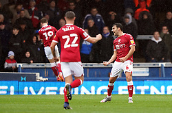 Bristol City's Matthew James celebrates their side's second goal of the game scored by George Tanner (background) during the Sky Bet Championship match at London Road, Peterborough. Picture date: Saturday October 2, 2021.