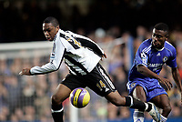 Photo: Marc Atkins.<br /> Chelsea v Newcastle United. The Barclays Premiership. 13/12/2006. Charles N'Zogbia of Newcastle in action with Salomon Kalou of Chelsea.