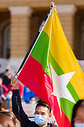 06 MARCH 2021 - DES MOINES, IOWA: A man waves the flag from Myanmar during a protest against the military coup in Myanmar. About 300 members of the Burmese community in Iowa gathered at the State Capitol in Des Moines Saturday to protest against the military coup that deposed the popularly elected government of Aung San Suu Kyi and continuing military oppression in Myanmar. There are about 10,000 people in Iowa's Burmese community.          PHOTO BY JACK KURTZ