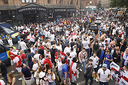 © Licensed to London News Pictures. 11/07/2021. London, UK. England supporters fill Charring Cross Road in central London on the day of the final of EURO 2020 at Wembley where England will play Italy. Photo credit: Peter Macdiarmid/LNP