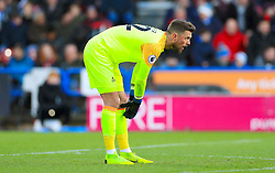 Huddersfield Town goalkeeper Ben Hamer looks dejected after his side concede their first goal during the Premier League match at the John Smith's Stadium, Huddersfield.