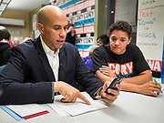 19 DECEMBER 2019 - URBANDALE, IOWA: US Senator CORY BOOKER (D-NJ) makes campaign calls to prospective caucus goers during a phone bank at his presidential campaign headquarters in Urbandale, a suburb of Des Moines. Sen. Booker, who did not qualify for the December 19 debate in Los Angeles, campaigned in the Des Moines area Thursday and visited the phone bank at his Iowa campaign headquarters. Iowa traditionally holds the first event of the presidential election cycle. The Iowa caucuses at Feb. 3, 2020.              PHOTO BY JACK KURTZ