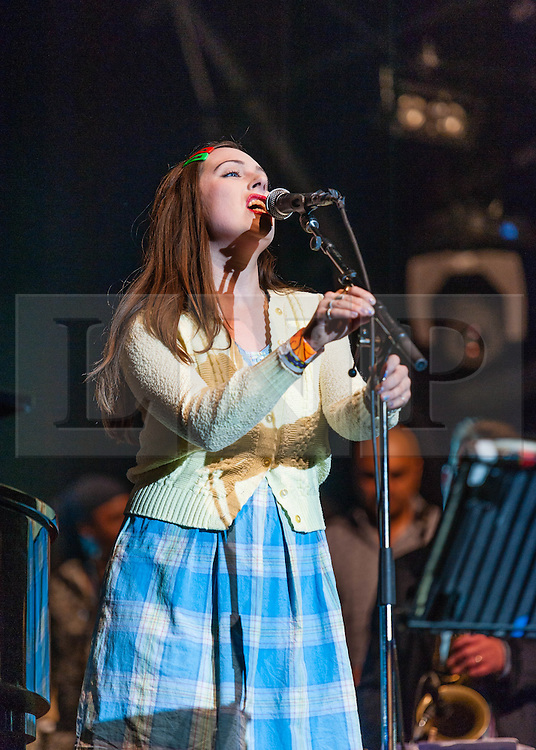 © Licensed to London News Pictures. 22/07/2012. London, UK.  Jools Holland and his Rhythm & Blues Orchestra performs live for BT's River of Music at the Europe stage, Somerset House.  In this pic - singer Rosie May.  Photo credit : Richard Isaac/LNP