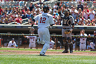 Chris Herrmann #12 of the Minnesota Twins scores against the Seattle Mariners on June 2, 2013 at Target Field in Minneapolis, Minnesota.  The Twins defeated the Mariners 10 to 0.  Photo: Ben Krause