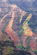 Evening light on the red ridges of Waimea Canyon, in Waimea Canyon State Park, Kauai, Hawaii.