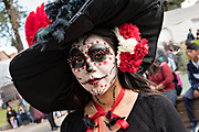 A young woman dressed in La Calavera Catrina costume for the Day of the Dead or Día de Muertos festival October 31, 2017 in Patzcuaro, Michoacan, Mexico. The festival has been celebrated since the Aztec empire celebrates ancestors and deceased loved ones.