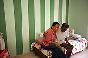 Mr and Mrs Jain in their apartment in the Florida style retirement community at Ashiana's Utsav in Bhiwadi, Rajasthan. Apartments range in price from £23000 to £40000 and are among the first real estate complexes of their kind for retirees in India