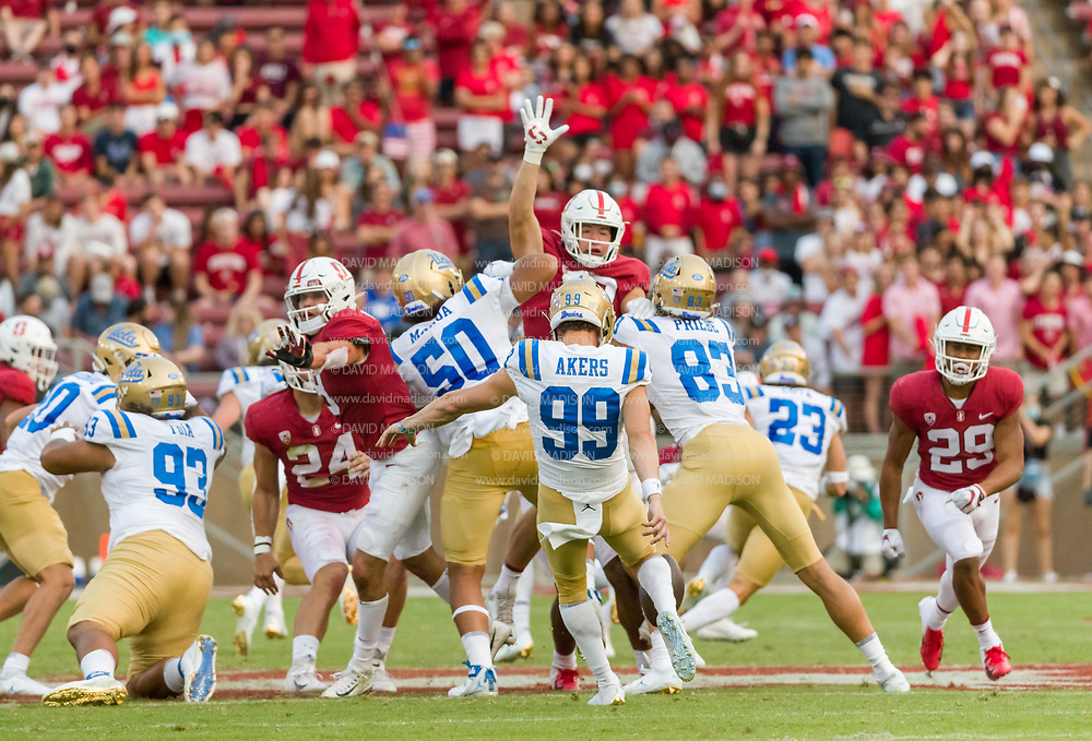PALO ALTO, CA - SEPTEMBER 26:  Luke Akers #99 of the UCLA Bruins punts the ball during an NCAA Pac-12 college football game against the Stanford Cardinal on September 26, 2021 at Stanford Stadium in Palo Alto, California.  (Photo by David Madison/Getty Images)
