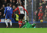 Football - 2017 / 2018 Premier League - Chelsea vs. Southampton<br /> <br /> Southampton goalkeeper, Fraser Forster, is beaten by Marcos Alonso 's free kick for his first half goal at Stamford Bridge.<br /> <br /> COLORSPORT/ANDREW COWIE