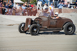 Lisa English in her 1929 Ford Roadster racing down the beach during The Race of Gentlemen. Wildwood, NJ, USA. October 11, 2015.  Photography ©2015 Michael Lichter.