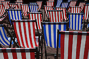 Chairs, The Victoria Embankment Gardens, a public park by the Thames was created in the late-19th century with the construction of the Embankment.  ..In the summer the gardens host a season of open-air concerts. .In the summer the gardens host a season of open-air concerts.