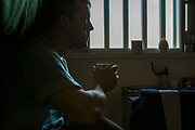 A enhanced prisoner sitting in his cell. HMP/YOI Portland, Dorset. A resettlement prison with a capacity for 530 prisoners. Dorset, United Kingdom.