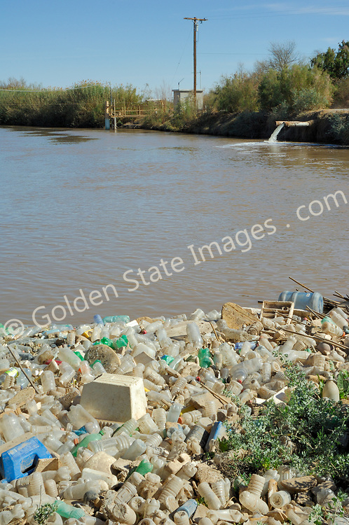 Along with the pollution litter such as discarded plastic bottles and styrofoam cups and containers collect along the banks of the New River.