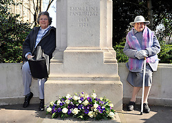 ©London News pictures. 08/03/11. 105-year-old former suffragette Hetty Bower (R) and her 79 year old daughter (L) at the statue of Emmeline Pankhurst to mark International Women's Day. She was  joined by Labour Leader Ed Miliband, Labour Deputy Leader Harriet Harman, and shadow home secretary Yvette Cooper. Emmeline  at the Pankhurst statue at Victoria Tower Gardens, Parliament Square, Westminster, London, Picture Credit should read Stephen Simpson/LNP