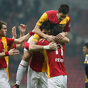 Galatasaray's Gokhan Zan (C) celebrate his goal with team mate during their Turkish Super League soccer match Galatasaray between MKE Ankaragucu at the TT Arena at Seyrantepe in Istanbul Turkey on Wednesday, 25 January 2012. Photo by TURKPIX