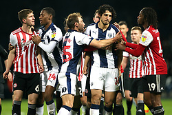 Brentford's Chris Mepham (left) and West Bromwich Albion's Ahmed Hegazi (second right) confront each other during the Skybet Championship match at The Hawthorns, West Bromwich.
