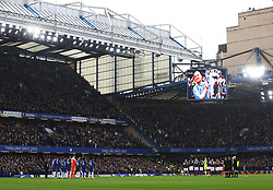 Chelsea and West Ham United players during a minute's applause in memory of the late Ray Wilkins in the stands before the game