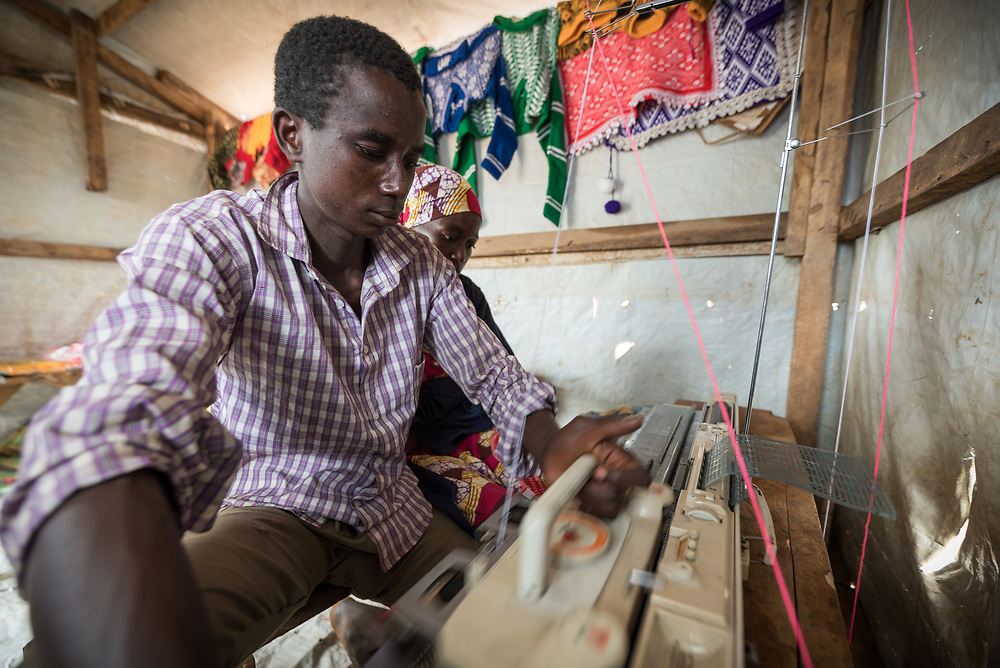 3 June 2019, Djohong, Cameroon: CAR refugee Muhammadu Tukur Yusufa is trainee in the Boutique Petit Piment ('The small peppers' boutique), a tailor's shop in the Borgop refugee camp grown out of a vocational training effort by the Lutheran World Federation. The Borgop refugee camp is located in the municipality of Djohong, in the Mbere subdivision of the Adamaoua regional state in Cameroon. Supported by the Lutheran World Federation since 2015, the camp currently holds 12,300 refugees from the Central African Republic.