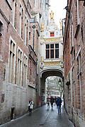 A bridge over a cobbled street near Burg in Bruges