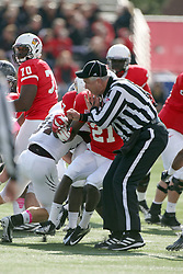 20 October 2012:  Umpire Steve Flanagan braces for a collision with Chick Shandrick during an NCAA Missouri Valley Football Conference football game between the Missouri State Bears and the Illinois State Redbirds at Hancock Stadium in Normal IL