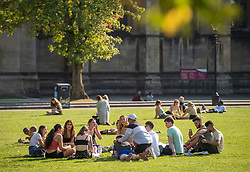 "© Licensed to London News Pictures; 21/09/2020; Bristol, UK. A group of 12 young people sit on College Green. Groups of people, some more than six in number, enjoy the sunshine and hot weather on the last official day of summer in Bristol city centre, amid concerns about a second wave of the covid-19 coronavirus pandemic across the UK, with many areas going into local lock down. From Monday 14 September it was illegal to meet up socially in groups of more than six people, known as the ""Rule of Six"", in order to try and contain the spread of the covid-19 coronavirus pandemic, and police have said they will enforce the law with fixed penalty notices which will increase for repeat offenders. Photo credit: Simon Chapman/LNP."