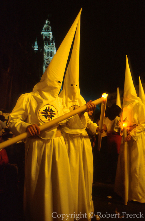 SPAIN, FESTIVALS Semana Santa (Holy Week) Easter processions in Seville with penitents wearing traditional robes and hoods for anonymity