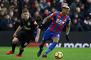 Patrick van Aanholt of Crystal Palace (R) in action with Matt Ritchie of Newcastle United (L). Premier League match, Crystal Palace v Newcastle Utd at Selhurst Park in London on Sunday 4th February 2018. pic by Steffan Bowen, Andrew Orchard sports photography.