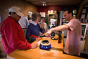 Keith Bodine pouring a tasting at Sweetgrass Winery, Union Maine.