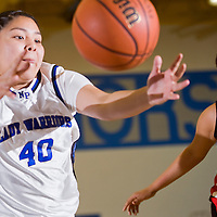 012613       Cable Hoover<br /> <br /> Navajo Pine Warrior Erin Dolfin (40) and Crownpoint Eagle Tarissa Platero (22) reach for loose ball Saturday at Navajo Pine High School.