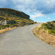 A road leading uphill in the middle of the Tabernas desert (Almeria, Andalucia, Spain).<br /> <br /> LICENSING: This is a Royalty Free (RF) image which can be licensed through SpacesImages. Click on the link below:<br /> <br /> http://tinyurl.com/c9s6gzo