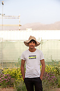 A farmer in the evening at The Sahara Forest Project on the outskirts of Aqaba, on Jordan's southern Red Sea coastline. The farm uses desalinated sea water and greenhouses to sustainably farm crops in land that was once aris desert.