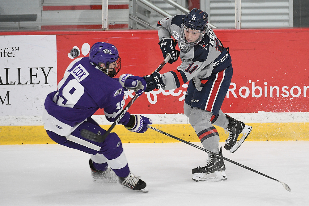PITTSBURGH, PA - MARCH 14: Brian Kramer #11 of the Robert Morris Colonials has his shot blocked by Ryan Cox #19 of the Niagara Purple Eagles in the first period during Game Three of the Atlantic Hockey Quarterfinal series at Clearview Arena on March 14, 2021 in Pittsburgh, Pennsylvania. (Photo by Justin Berl/Robert Morris Athletics)