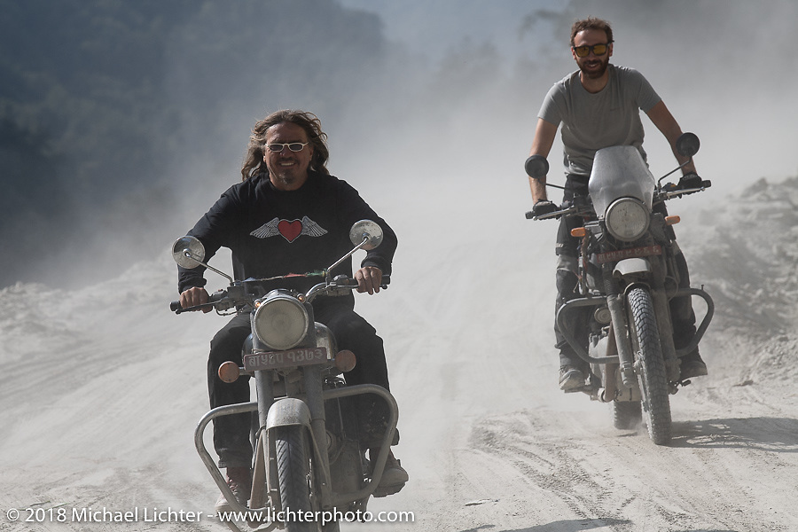 Beanre (Kevin Doebler) (L) and Sean Lichter on a particularly dusty part of the route on Day-7 of our Himalayan Heroes adventure riding from Tatopani to Pokhara, Nepal. Monday, November 12, 2018. Photography ©2018 Michael Lichter.