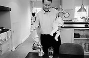 David Cameron, Conservative Party Leader and Conservative MP for Whitney, Oxfordshire, UK pours coffee at home with his youngest child Arthur.
