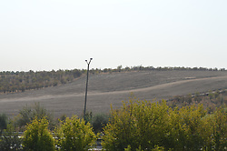 September 11, 2017 - Ankara, Turkey - The construction site of a new road project is pictured after cutting through the Middle East Technical University's (METU) forested campus in Ankara, Turkey on September 11, 2017. The university's rector Prof. Dr. Mustafa Versan Kok recently announced that the rectorship and the Ankara Metropolitan Municipality signed a protocol on a new road project of 4.8 kilometres in length passing through the university with the destruction around 24 hectares of the forest land. In the late evening hours of September 09, approximately 500 trucks and construction equipments with hundreds of police officers escorting them unexpectedly started to cut down the trees in the land a day after the signing the protocol. (Credit Image: © Altan Gocher/NurPhoto via ZUMA Press)