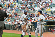 Milwaukee Brewers center fielder Nyjer Morgan celebrates with teammate Norichika Aoki after scoring on a Corey Hart (not shown) 3-run home run against the Minnesota Twins at Target Field in Minneapolis, Minnesota on June 17, 2012.  The Twins defeated the Brewers 5 to 4 in 15 innings.  The game was the longest in Target Field history.  © 2012 Ben Krause