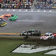 NASCAR Sprint Cup drivers Danica Patrick (10), Matt Kenseth (20), Kyle Larson (42), and Denny Hamlin (11) are involved in a crash on the front stretch during the 56th Annual NASCAR Coke Zero 400 race at Daytona International Speedway on Sunday, July 6, 2014 in Daytona Beach, Florida.  (AP Photo/Alex Menendez)