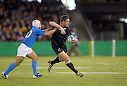 11 October 2003, Rugby World Cup, First pool D match, All Blacks vs Italy, Telstra Dome, Melbourne, Australia.<br />Mark Hammett fends off Italy defence. NZ won 70-7.<br />Pic: Sandra Teddy/Photosport