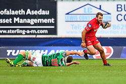 Scarlets' Paul Asquith evades the tackle of Benetton Treviso's Marco Fuser<br /> <br /> Photographer Simon King/Replay Images<br /> <br /> EPCR Champions Cup Round 3 - Scarlets v Benetton Rugby - Saturday 9th December 2017 - Parc y Scarlets - Llanelli<br /> <br /> World Copyright © 2017 Replay Images. All rights reserved. info@replayimages.co.uk - www.replayimages.co.uk