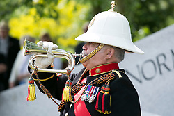 © Licensed to London News Pictures. 06/06/2014. National Memorial Arboretum, Alrews, Staffordshire, UK. The D Day service at the Normandy Memorial, National Memorial Arbouretum. Pictured, the last post is played. Photo credit : Dave Warren/LNP