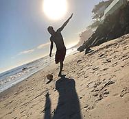 Former football star David Beckham playing beach soccer
