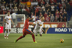 March 1, 2018 - Harrison, New Jersey, United States - Club Deportivo Olimpia Defender BRYAN JOHNSON (12) fouls New York Red Bulls midfielder DANIEL ROYER (77) while fighting for the ball during the CONCACAF Champions league match at Red Bull Arena in Harrison, NJ.  NY Red Bulls defeat CD Olimpia 2-0  (Credit Image: © Mark Smith via ZUMA Wire)