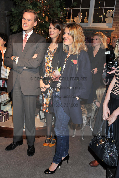 Left to right, JAMES & GENEVIEVE OSBORNE and The HON.VIRGINIA FRASER at a party to celebrate the launch of Carol Woolton's book 'Drawing Jewels For Fashion' held at Asprey, 167 New Bond Street, London W1 on 10th November 2011.