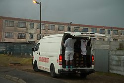 """Volunteers deliver bread to the community of Parkwood, a subburb of Cape Town, located on the Cape Flats, Monday, April 20, 2020. The majority of the people who live here are unemployed during """"normal"""" circumstances. And as South Africa is now in lockdown due to the Coronavirus, many of those who had jobs have also lost their income. So many people are starving. The feeding scheme is a joint community effort, paid for solely by donations from the public to feed more than 3,000 households. The group is also receiving transportation support by The South African Red Cross Society. PHOTO: EVA-LOTTA JANSSON"""