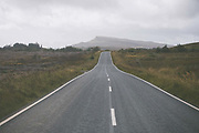 An empty road, the A855 running along the east coast of the Isle of Skye on the 3rd September 2016 near Portree, Scotland in the United Kingdom.